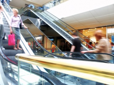 People Riding an Escalator